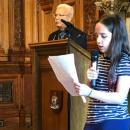 Olivia welcomes the audience at Glasgow City Chambers